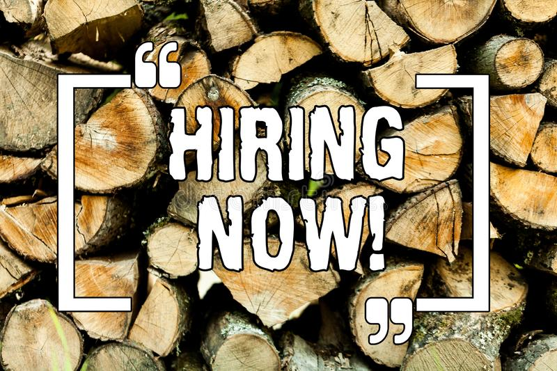 Text sign showing Hiring Now. Conceptual photo Workforce Wanted New Employees Recruitment Wooden background vintage wood wild. Message ideas intentions thoughts royalty free stock image