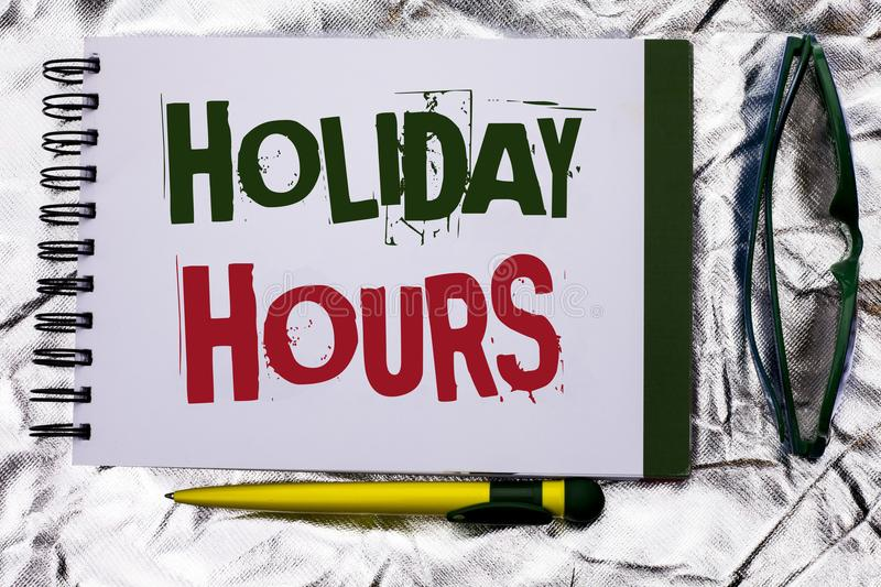 Text sign showing Holiday Hours. Conceptual photo Celebration Time Seasonal Midnight Sales Extra-Time Opening written on Notebook. Text sign showing Holiday royalty free stock images