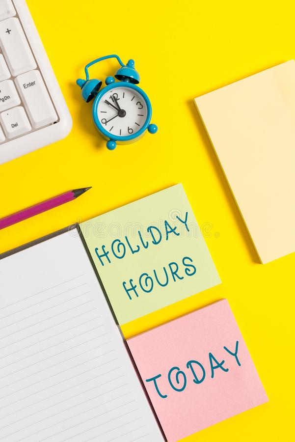 Text sign showing Holiday Hours. Conceptual photo employee receives twice their normal pay for all hours. Text sign showing Holiday Hours. Business photo text stock photography