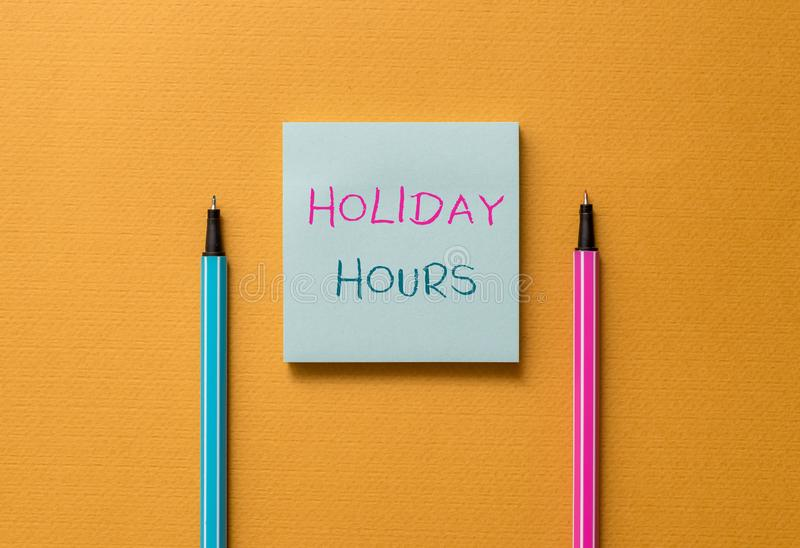Text sign showing Holiday Hours. Conceptual photo employee receives twice their normal pay for all hours Front view. Text sign showing Holiday Hours. Business stock photo