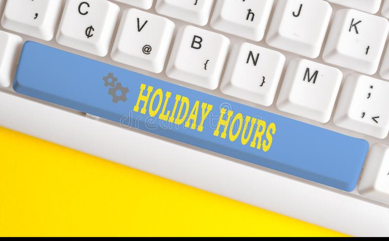 Text sign showing Holiday Hours. Conceptual photo employee receives twice their normal pay for all hours White pc. Text sign showing Holiday Hours. Business royalty free stock photo