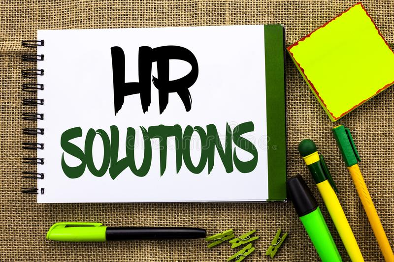Text sign showing Hr Solutions. Conceptual photo Recruitment Solution Consulting Management Solving Onboarding written on Notebook royalty free stock image