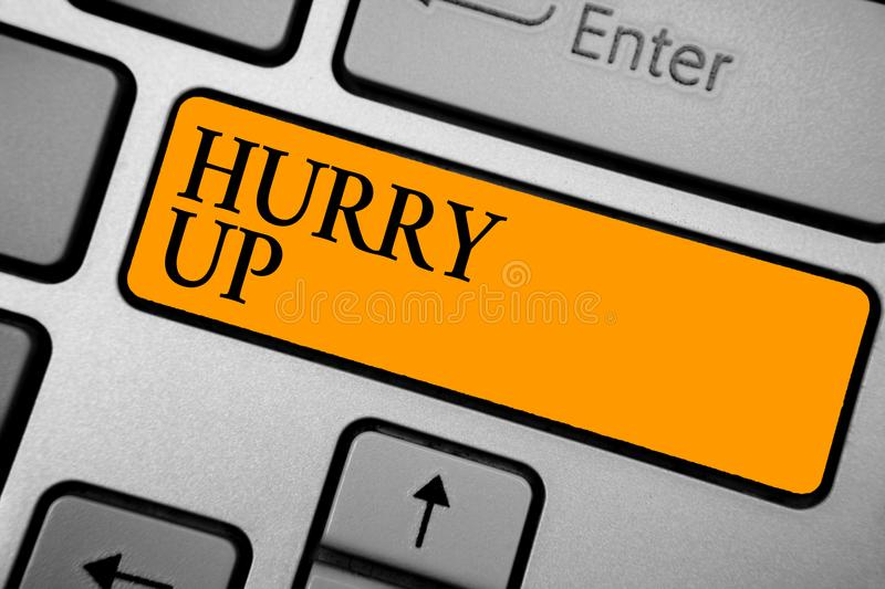 Text sign showing Hurry Up. Conceptual photo asking someone to do a job very fast Quickly Lets go Encourage Keyboard orange key In. Tention create computer stock photos