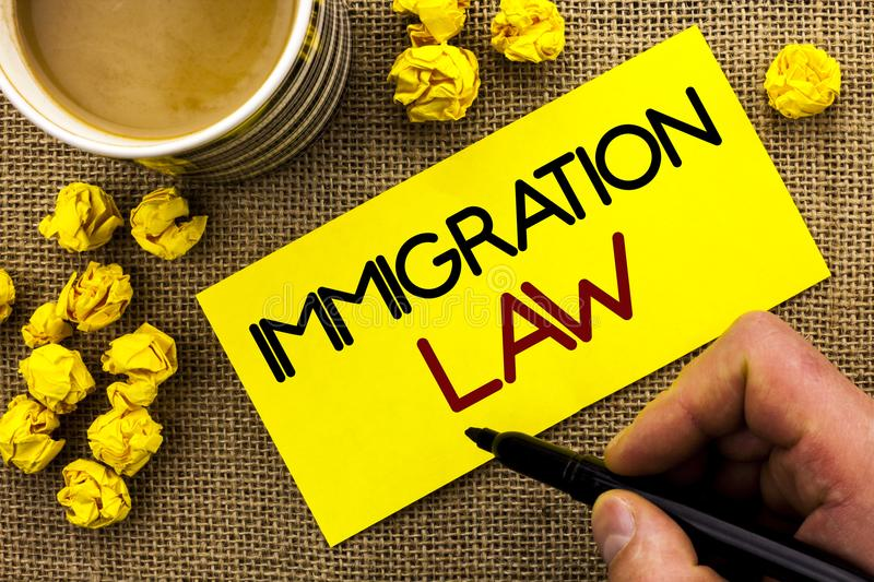 Text sign showing Immigration Law. Conceptual photo National Regulations for immigrants Deportation rules written on Sticky Note P. Text sign showing Immigration royalty free stock photos