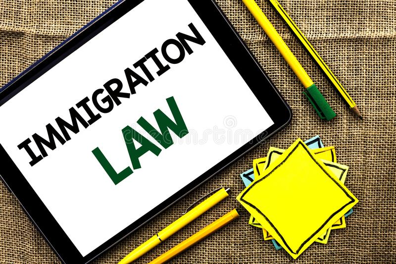 Text sign showing Immigration Law. Conceptual photo National Regulations for immigrants Deportation rules written on Tablet on the. Text sign showing Immigration stock photos