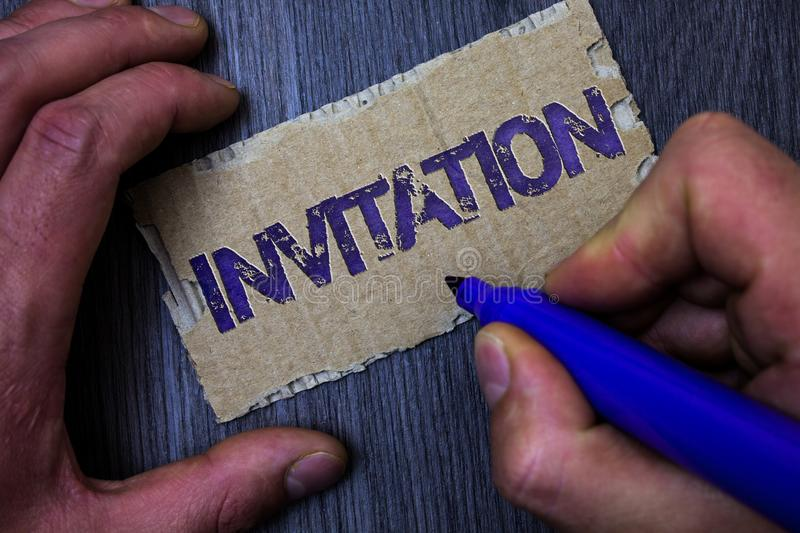 Text sign showing Invitation. Conceptual photo Written or verbal request someone to go somewhere or do something Man working holdi. Ng blue marker ideas message stock image