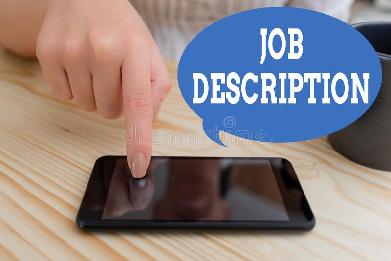 Text sign showing Job Description. Conceptual photo a formal account of an employee s is responsibilities woman using. Text sign showing Job Description royalty free stock photography