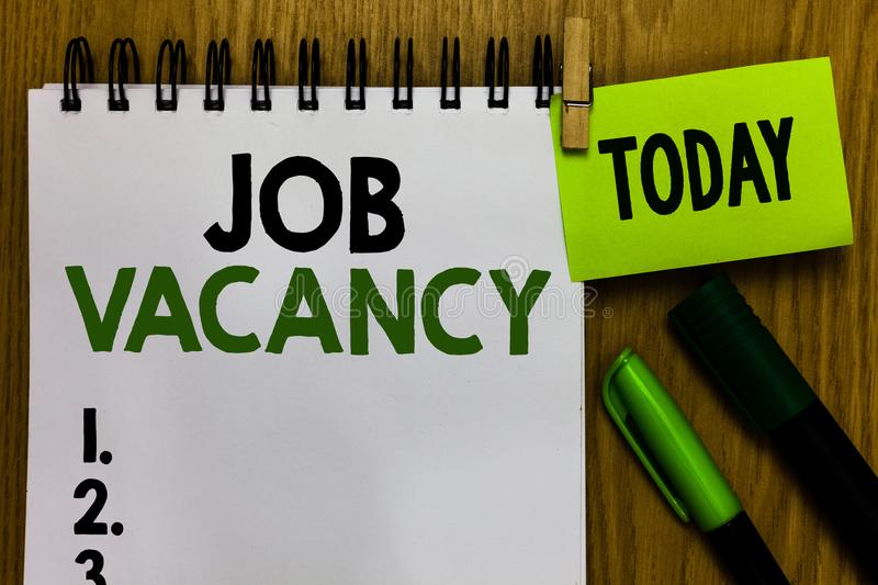 Text sign showing Job Vacancy. Conceptual photo empty or available paid place in small or big company Notebook clothespin holding. Reminder markers expressing royalty free stock photo