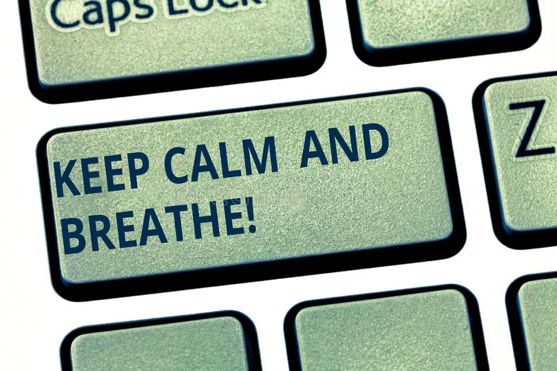Text sign showing Keep Calm And Breathe. Conceptual photo Take a break to overcome everyday difficulties Keyboard key. Intention to create computer message royalty free stock photography