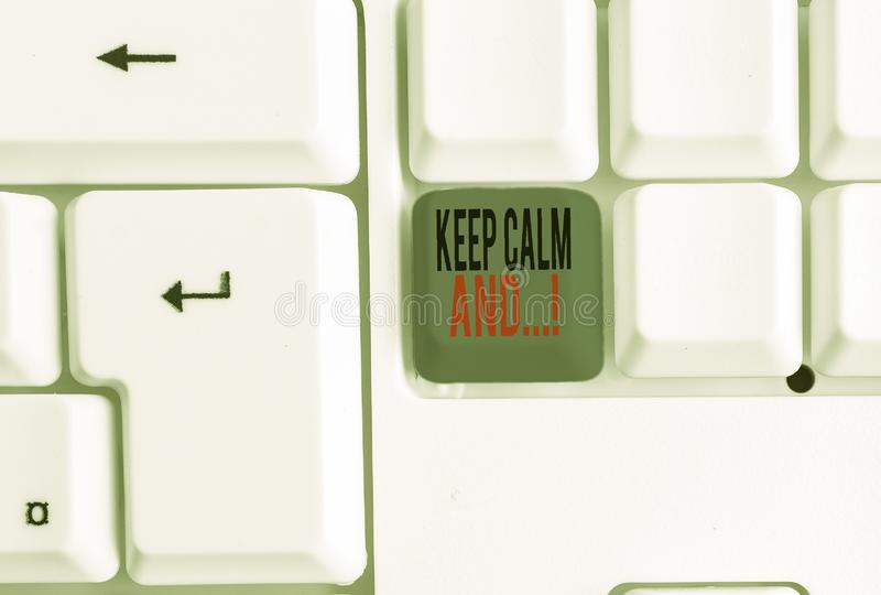 Text sign showing Keep Calm And. Conceptual photo motivational poster produced by British government White pc keyboard. Text sign showing Keep Calm And. Business stock images