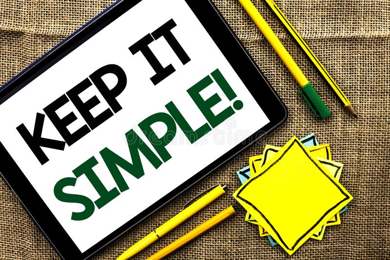 Text sign showing Keep It Simple Motivational Call. Conceptual photo Simplify Things Easy Clear Concise Ideas written on Tablet on. Text sign showing Keep It stock images