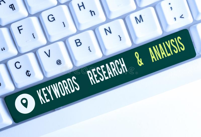 Text sign showing Keywords Research And Analysis. Conceptual photo search for data and create tables graphs White pc. Text sign showing Keywords Research And royalty free stock photo