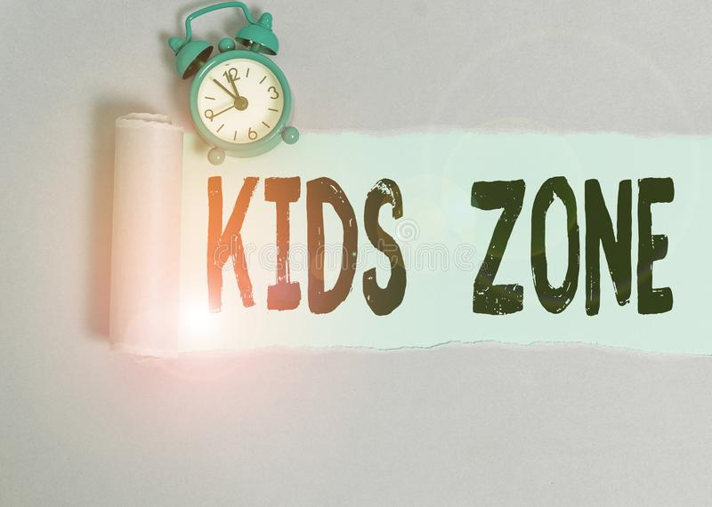 Text sign showing Kids Zone. Conceptual photo An area or a region designed to enable children to play and enjoy Alarm royalty free stock image