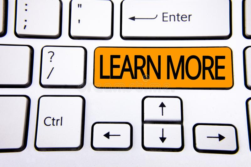 Text sign showing Learn More. Conceptual photo Study harder Develop new skills abilities Get extra education written on Orange Key. Text sign showing Learn More stock images