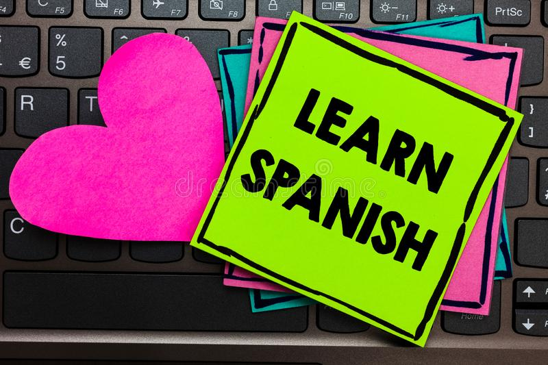 Text sign showing Learn Spanish. Conceptual photo Translation Language in Spain Vocabulary Dialect Speech Papers Romantic lovely m. Essage Heart Keyboard Type royalty free stock images