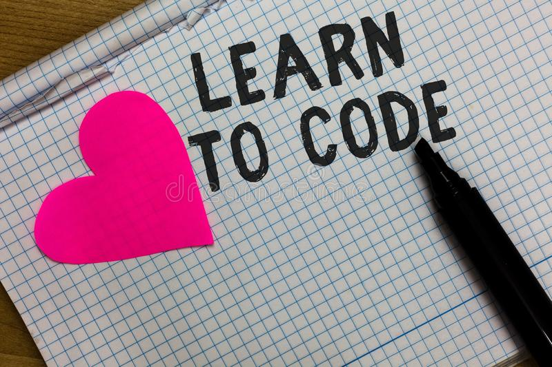 Text sign showing Learn To Code. Conceptual photo Learn to write Software Be a Computer Programmer Coder Squared notebook paper ri. Pped sheets Marker romantic stock images