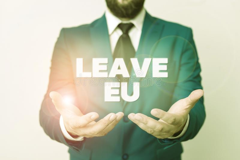 Text sign showing Leave Eu. Conceptual photo An act of a demonstrating to leave a country that belongs to Europe Man. Text sign showing Leave Eu. Business photo royalty free stock photos