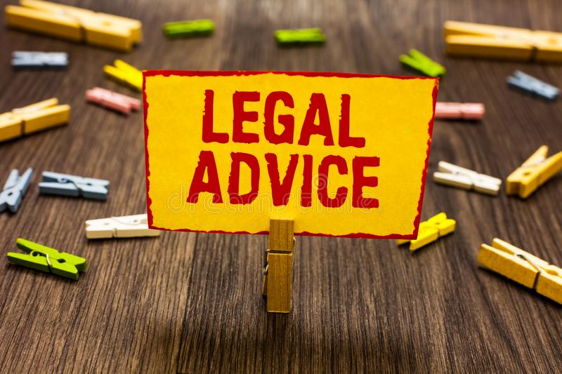 Text sign showing Legal Advice. Conceptual photo Lawyer opinion about law procedure in a particular situation Clothespin holding y. Ellow paper note several royalty free stock photo