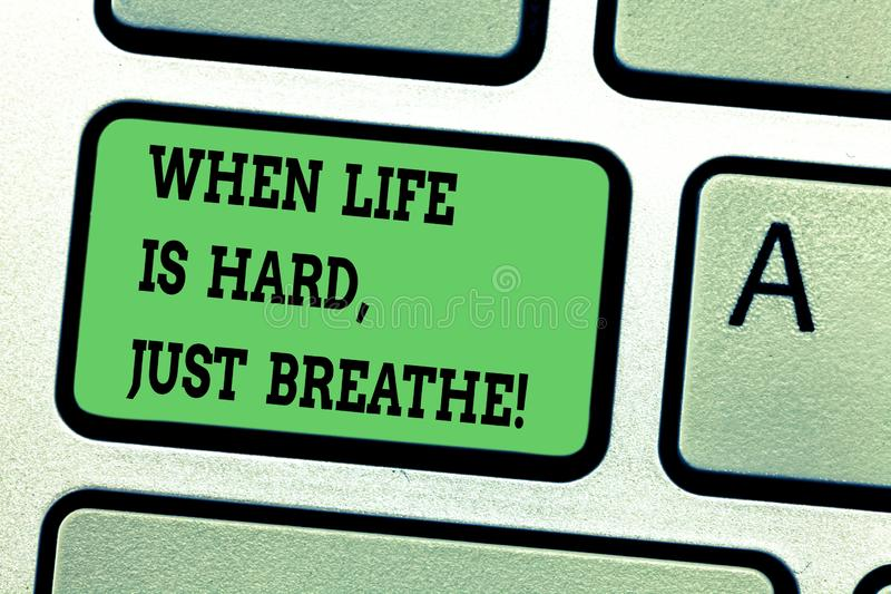 Text sign showing When Life Is Hard Just Breathe. Conceptual photo Take a break to overcome difficulties Keyboard key. Intention to create computer message royalty free stock photos