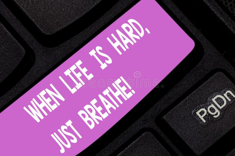 Text sign showing When Life Is Hard Just Breathe. Conceptual photo Take a break to overcome difficulties Keyboard key. Intention to create computer message royalty free stock images