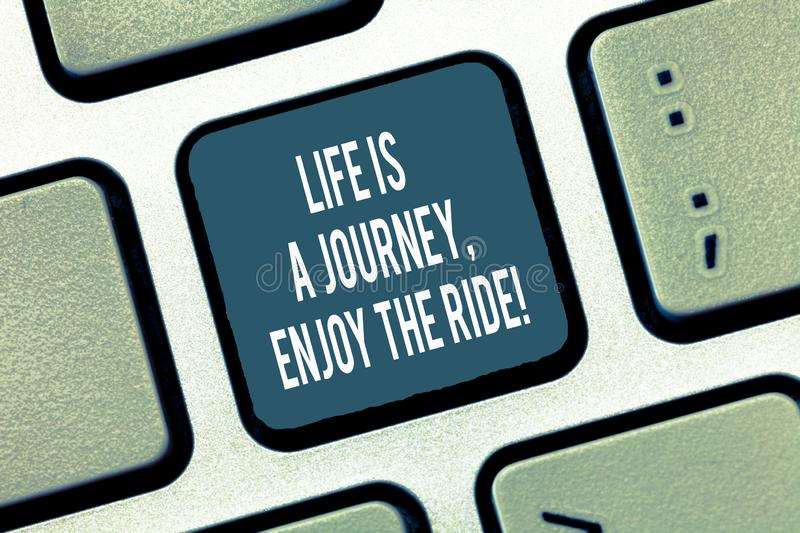 Text sign showing Life Is A Journey Enjoy The Ride. Conceptual photo Enjoying things that happen everyday Keyboard key. Intention to create computer message royalty free stock image