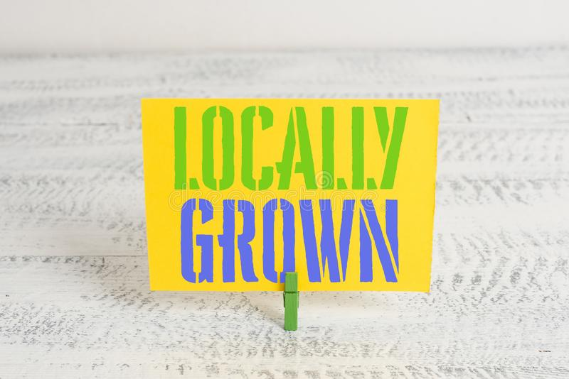Text sign showing Locally Grown. Conceptual photo Produced Agricultural Countryside Fresh Vegetables Green clothespin. Text sign showing Locally Grown. Business royalty free stock photography
