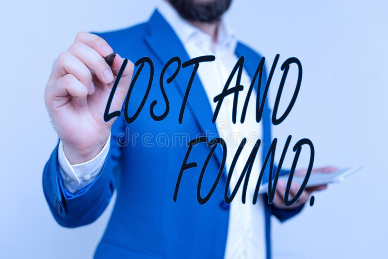 Text sign showing Lost And Found. Conceptual photo a place where lost items are stored until they reclaimed Businessman royalty free stock photo