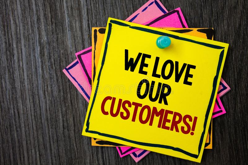 Text sign showing We Love Our Customers Call. Conceptual photo Client deserves good service satisfaction respect Wooden background. Ideas messages intentions stock photography