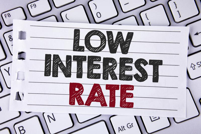 Text sign showing Low Interest Rate. Conceptual photo Manage money wisely pay lesser rates save higher written on Notebook paper p royalty free stock photo