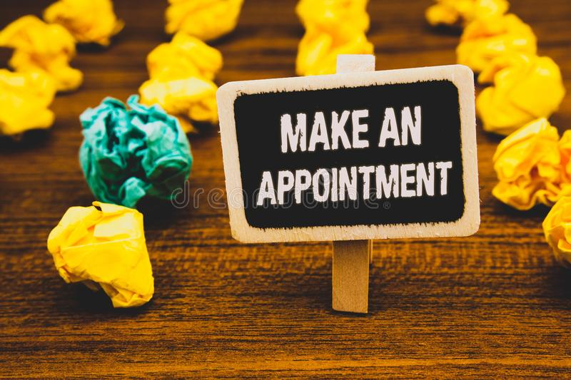 Text sign showing Make An Appointment. Conceptual photo Schedule Arrangement Deadline Session Engagement Blackboard with letters w. Ooden floor blurry yellow stock images