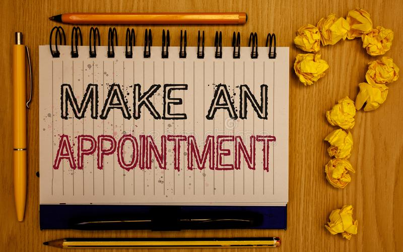 Text sign showing Make An Appointment. Conceptual photo Schedule Arrangement Deadline Session Engagement Notepad with outline text. Pen pencil woody desk crimp royalty free stock photo