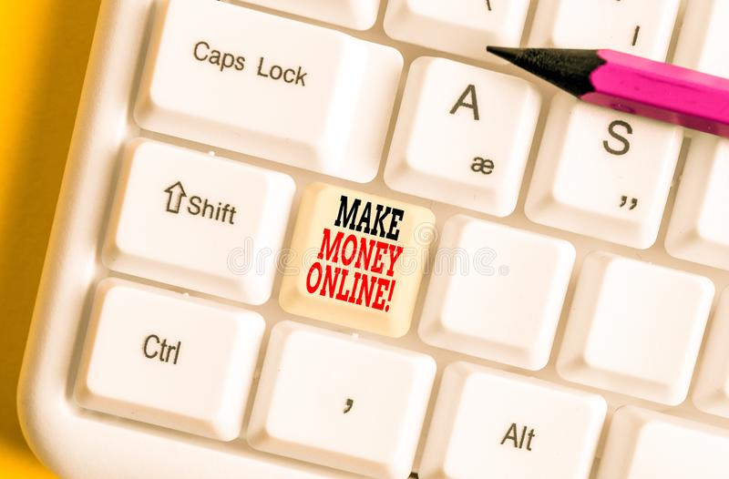 Text sign showing Make Money Online. Conceptual photo making profit using internet like freelancing or marketing White pc keyboard. Text sign showing Make Money stock image