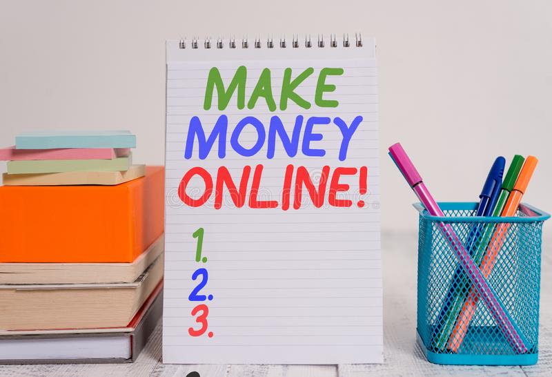 Text sign showing Make Money Online. Conceptual photo making profit using internet like freelancing or marketing Pens metal holder. Text sign showing Make Money stock photo