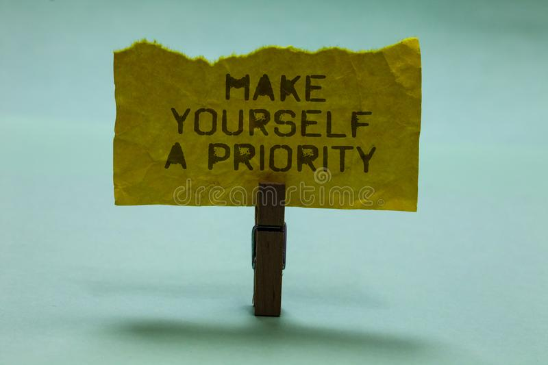 Text sign showing Make Yourself A Priority. Conceptual photo Think in your own good first personal development Paperclip hold torn. Yellow page written brown stock photos