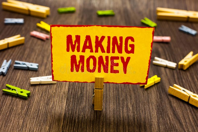 Text sign showing Making Money. Conceptual photo Giving the opportunity to make a profit Earn financial support Clothespin holding stock photo