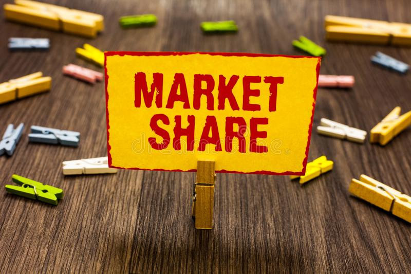 Text sign showing Market Share. Conceptual photo The portion of a market controlled by a particular company Clothespin holding yel. Low paper note several royalty free stock photo
