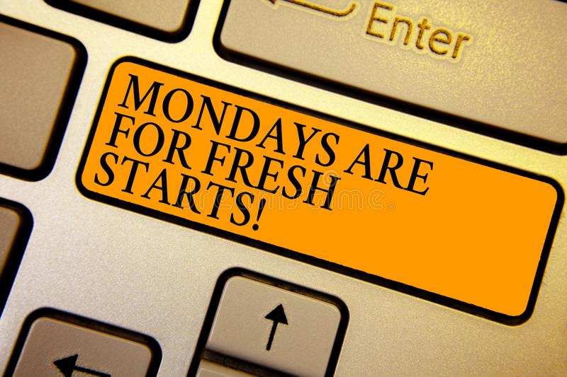 Text sign showing Mondays Are For Fresh Starts. Conceptual photo Begin again every week have a good morning Keyboard orange key In. Tention create computer royalty free stock photography