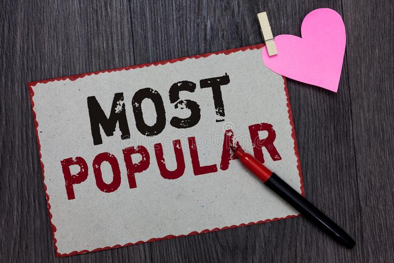 Text sign showing Most Popular. Conceptual photo Liked Followed Enjoyed by majority of the people in a society White page red bord. Ers marker clothespin holds royalty free stock photography