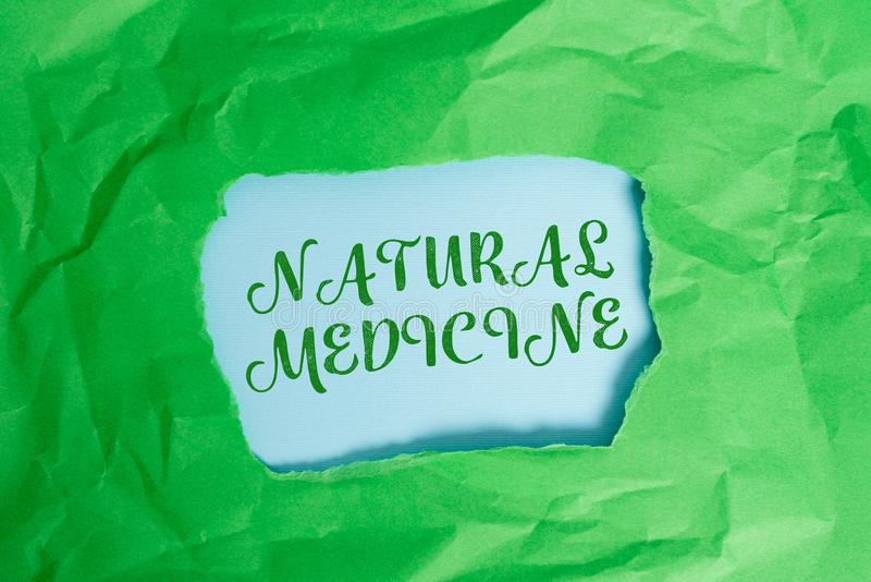 Text sign showing Natural Medicine. Conceptual photo any of various systems of healing or treating disease Green crumpled ripped. Text sign showing Natural royalty free stock image