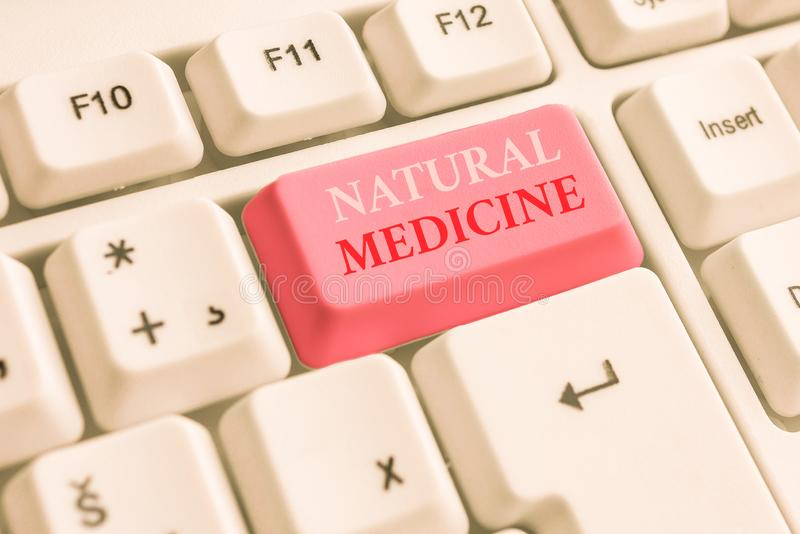 Text sign showing Natural Medicine. Conceptual photo any of various systems of healing or treating disease White pc. Text sign showing Natural Medicine. Business royalty free stock image