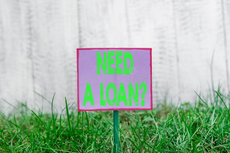 Text sign showing Need A Loan Question. Conceptual photo asking he need money expected paid back with interest Plain. Text sign showing Need A Loan Question stock image
