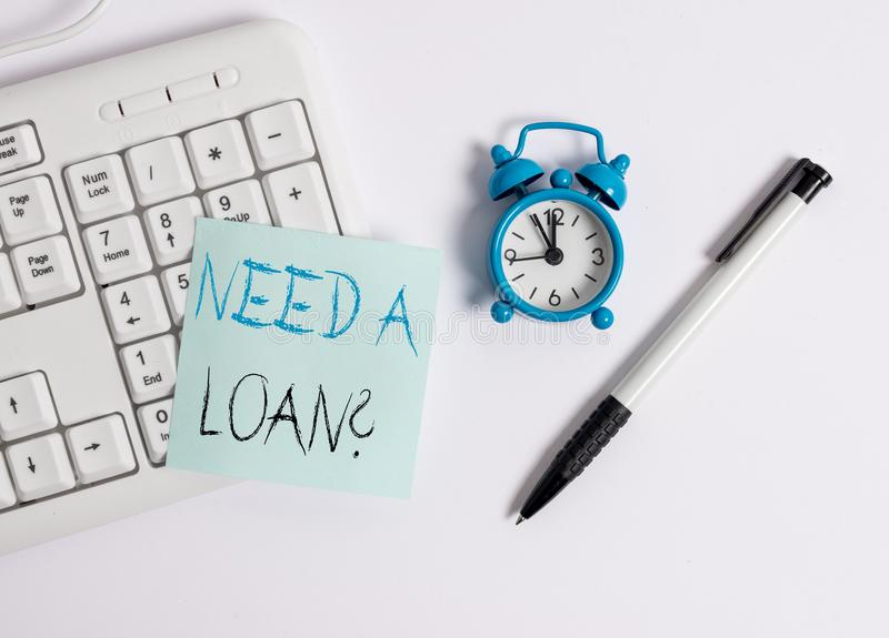 Text sign showing Need A Loan Question. Conceptual photo asking he need money expected paid back with interest White pc. Text sign showing Need A Loan Question stock images