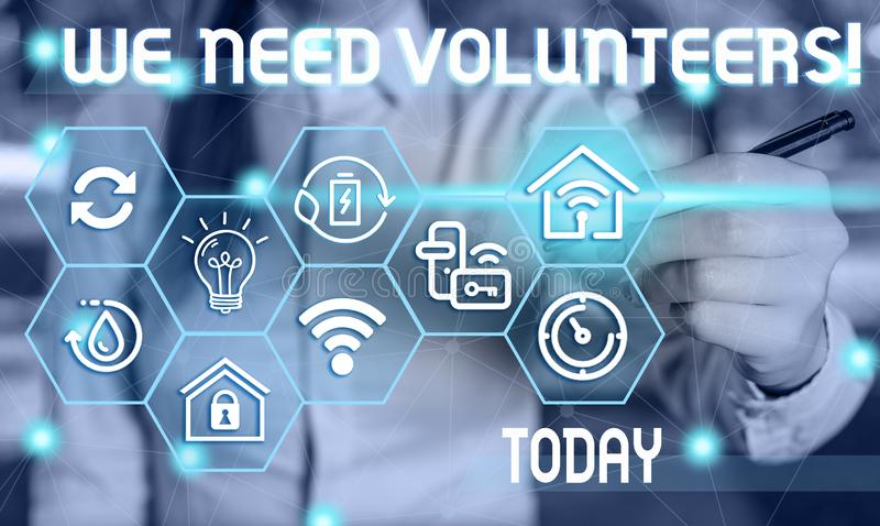 Text sign showing We Need Volunteers. Conceptual photo someone who does work without being paid for it Female human wear. Text sign showing We Need Volunteers royalty free stock photos