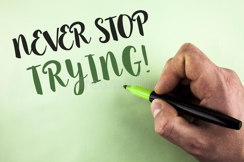 Text sign showing Never Stop Trying Motivational Call. Conceptual photo go on do not give up Self confidence written by Man holdin. G Marker in Hand plain royalty free stock images