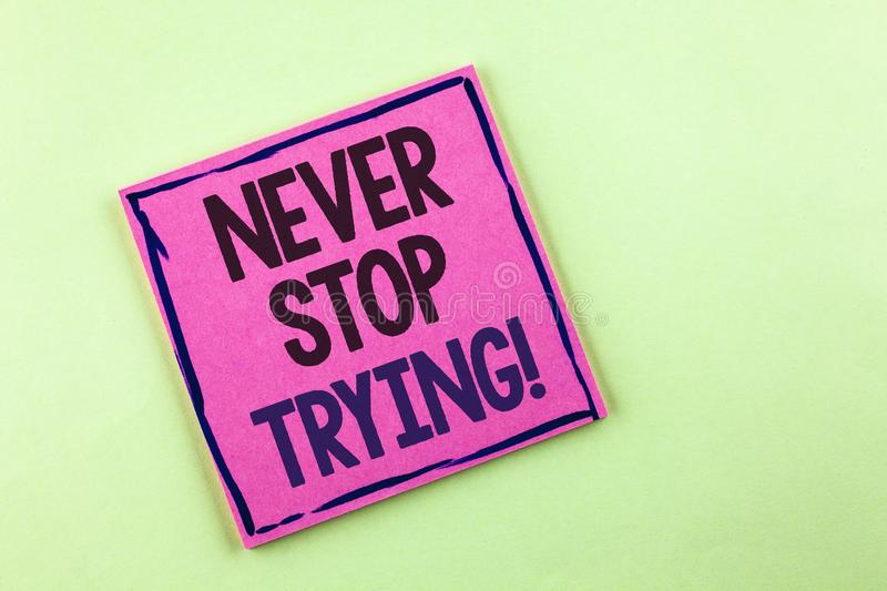 Text sign showing Never Stop Trying Motivational Call. Conceptual photo go on do not give up Self confidence written on Pink Stick. Text sign showing Never Stop stock image