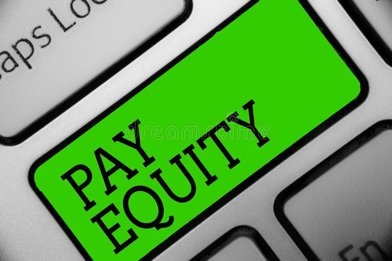 Text sign showing Pay Equity. Conceptual photo eliminating sex and race discrimination in wage systems Keyboard green key Intentio. N create computer computing royalty free stock image