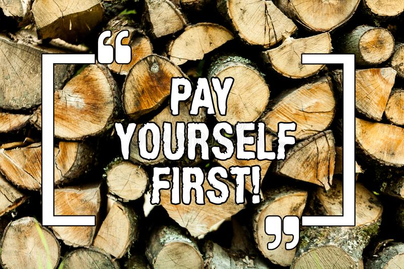 Text sign showing Pay Yourself First. Conceptual photo Personal Finance Save money for future Wooden background vintage wood wild. Message ideas intentions royalty free stock photos