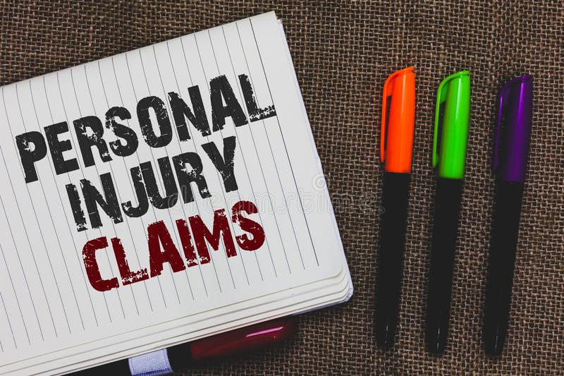 Text sign showing Personal Injury Claims. Conceptual photo being hurt or injured inside work environment Open notebook page jute b. Ackground colorful markers stock images