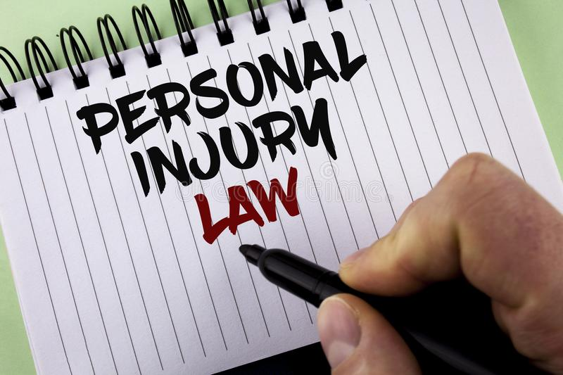 Text sign showing Personal Injury Law. Conceptual photo guarantee your rights in case of hazards or risks written by Man on Notepa. Text sign showing Personal royalty free stock image
