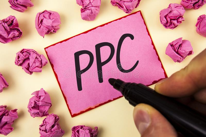 Text sign showing Ppc. Conceptual photo Pay Per Click Advertising Strategies Direct Traffic to Websites written by Man on Sticky N. Text sign showing Ppc royalty free stock images